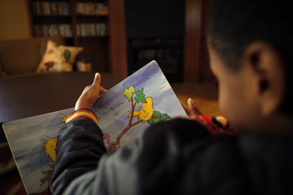 A 7-year-old resident at Jonathan's Place reads a book Thursday, March 31, 2016 in Garland, Texas. In its 25th year, Jonathan's Place offers an emergency children's shelter, as well as foster care, adoption services and a residential treatment program for girls. (G.J. McCarthy/The Dallas Morning News)