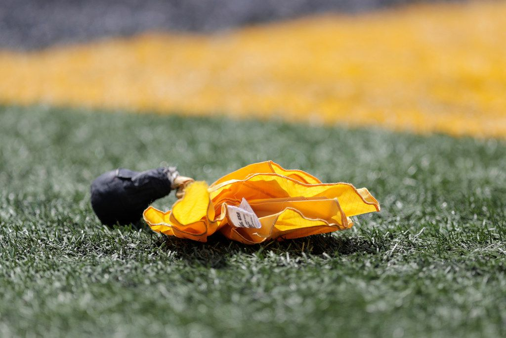 A flag is seen in the end zone after a pass interference call on the Howard defense during the first half of an NCAA college football game against Maryland, Saturday, Aug. 31, 2019, in College Park, Md. (AP Photo/Julio Cortez)