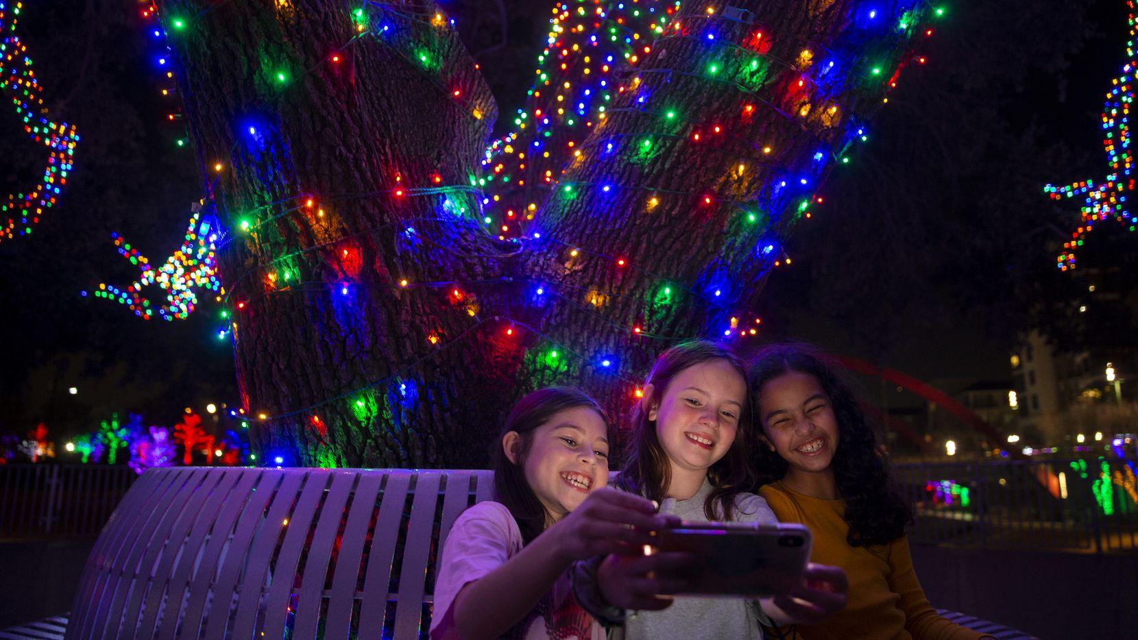Friends take a selfie at Vitruvian Lights at Vitruvian Park.