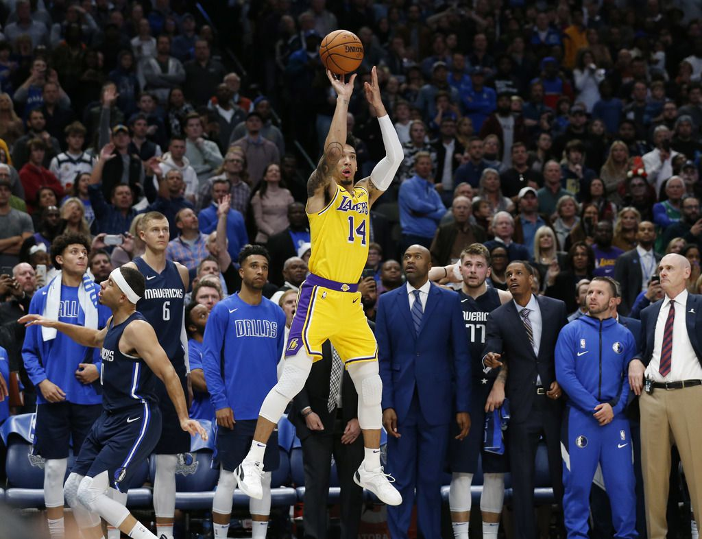 Los Angeles Lakers guard Danny Green (14) shoots and makes the three pointer to tie the game in the final seconds of regulation as Dallas Mavericks guard Seth Curry (30) passes by him during the second half of play at American Airlines Center in Dallas on Friday, November 1, 2019. (Vernon Bryant/The Dallas Morning News)