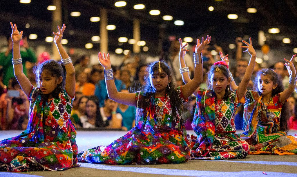 Children in dance teams perform on stage during Diwali Mela at Fair Park in 2016.