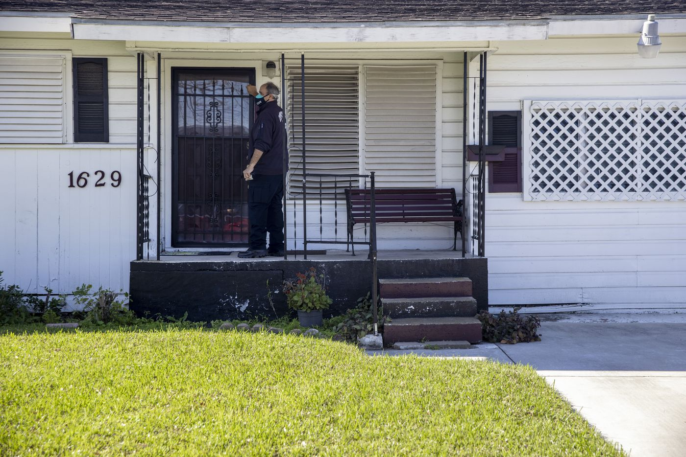 Firefighter II/EMT Steve Bowers knocks on a home of a Meals for Wheels recipient in Corpus Christi, Texas, on Monday, Feb. 1, 2021. The Corpus Christi Fire Department has spearheaded a program for administering COVID-19 vaccines to vulnerable elderly populations through utilizing existing rosters kept by the city's Meals on Wheels initiative and those of other civil senior service programs. (Lynda M. González/The Dallas Morning News)