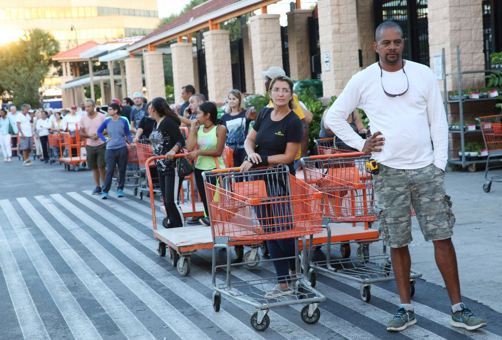 Eduardo Soriano of Miami waited in line for hours Wednesday to purchase plywood sheets at a Home Depot  in North Miami.