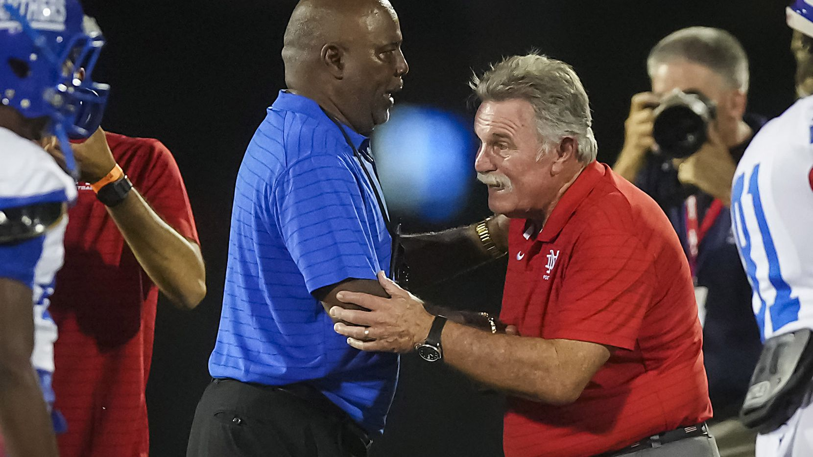 Duncanville head coach Reginald Samples (left) shakes hands with Mater Dei head coach Bruce Rollinson  after a high school football game on Friday, Aug. 27, 2021, in Duncanville.