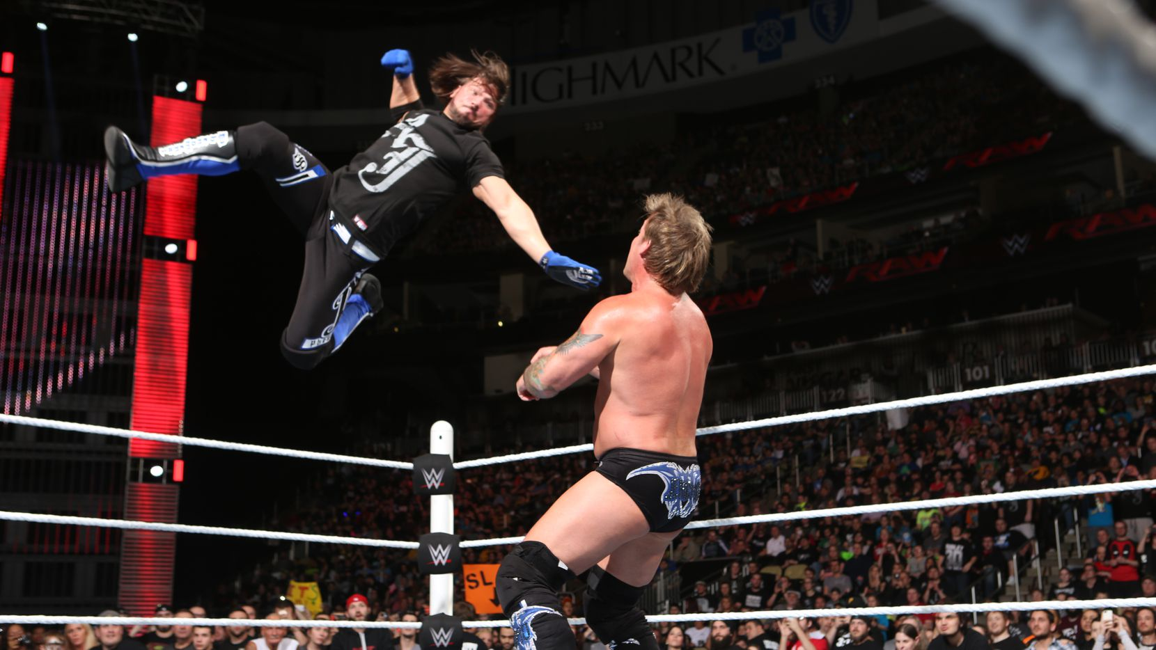 AJ Styles prepares to hit Chris Jericho with a flying forearm on an epsiode of Monday Night Raw. (Photo courtesy: WWE)