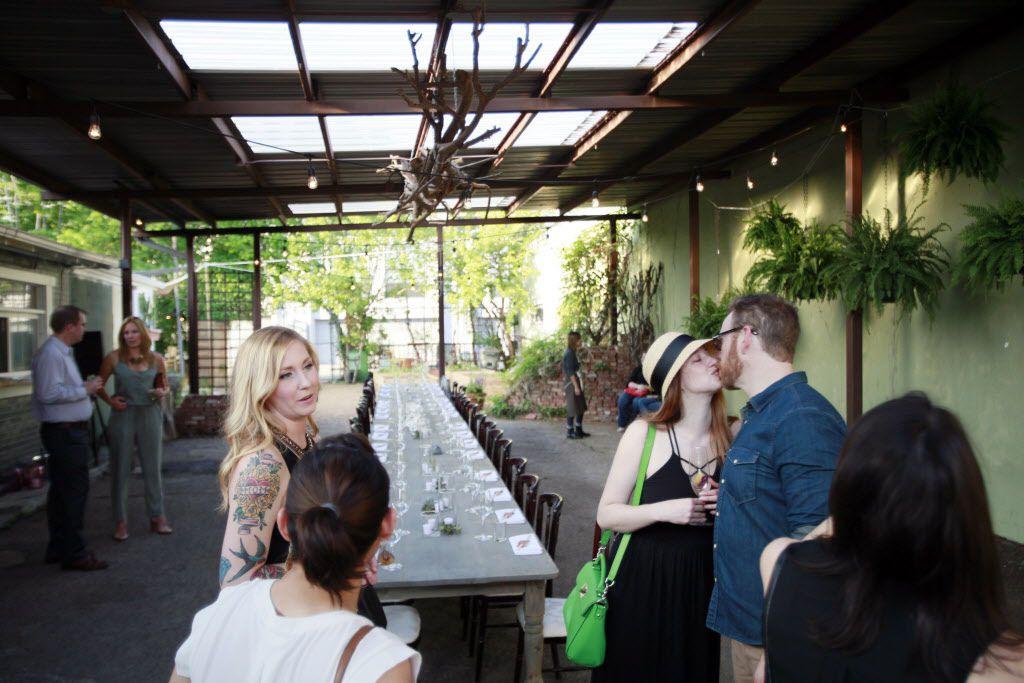 Shelley Knott, right, and Matt Ragan, both of Dallas, kiss during a pop-up dinner for Uchi.