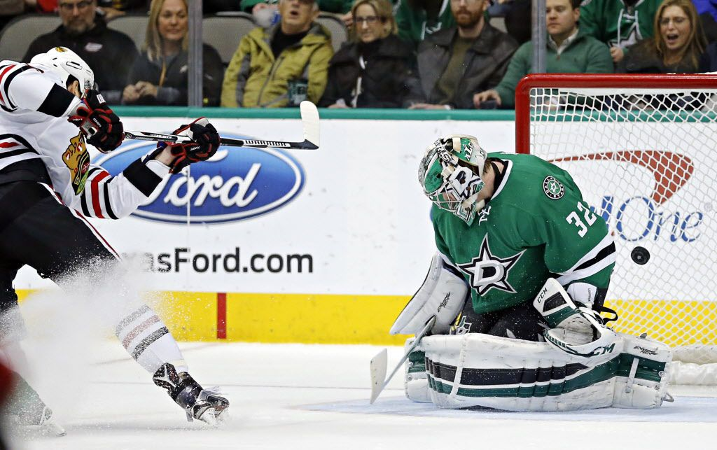 Chicago Blackhawks center Artem Anisimov (left) gets a shot past Dallas Stars goalie Kari Lehtonen during the second period of their game Saturday, February 6, 2016 at the American Airlines Center in Dallas. (G.J. McCarthy/The Dallas Morning News)