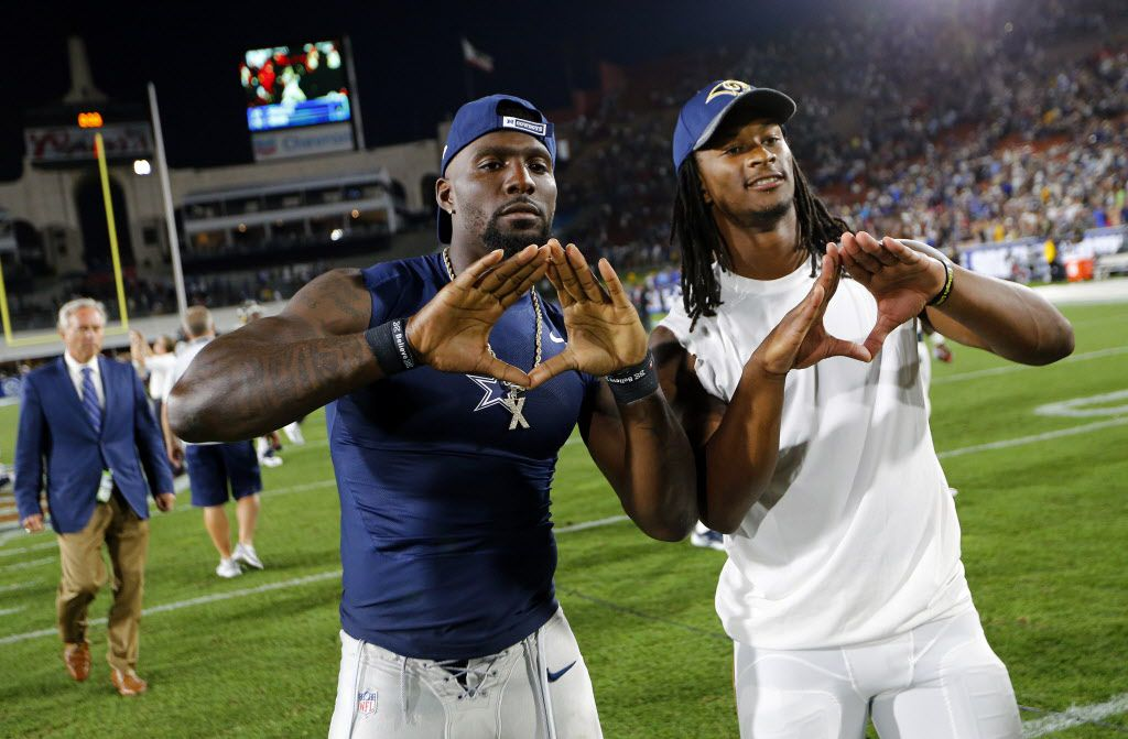 Dallas Cowboys wide receiver Dez Bryant (left) and Los Angeles Rams running back Todd Gurley pose for photos after they exchanged jerseys following their first preseason game at the Los Angeles Memorial Coliseum, Saturday, August 13, 2016. The Cowboys lost 28-24. The two traded jerseys. (Tom Fox/The Dallas Morning News)