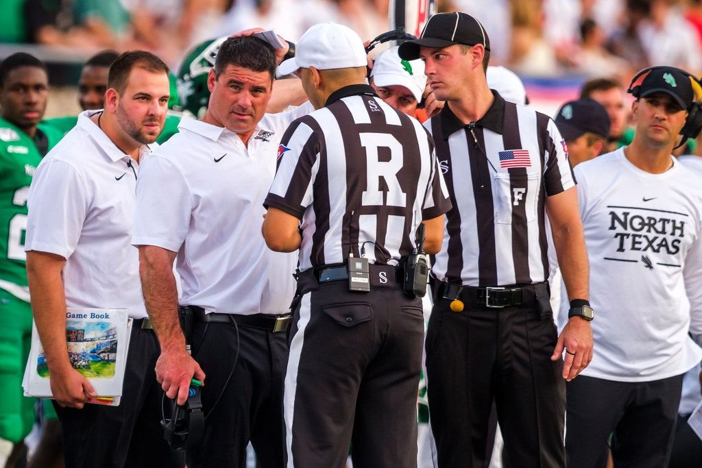 UNT head coach Seth Littrell talks to the officials during the first half of an NCAA football game against SMU at Ford Stadium on Saturday, Sept. 7, 2019.