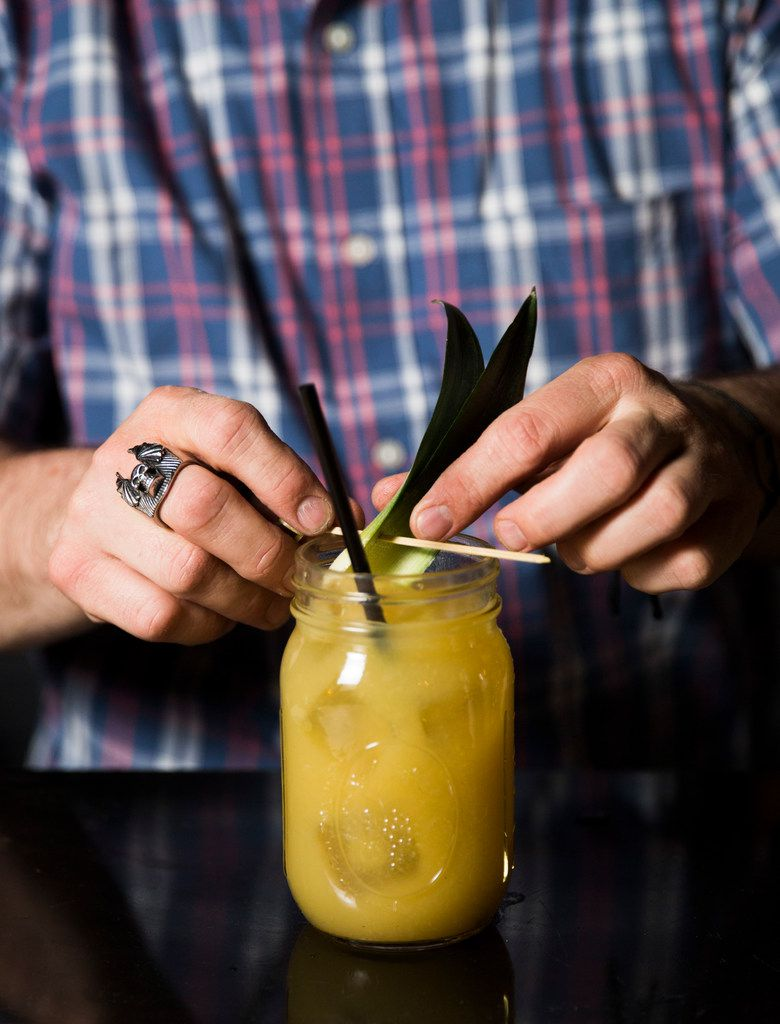 Bartender Chris Dempsey garnishes house-made tepache at Las Almas Rotas in Dallas.