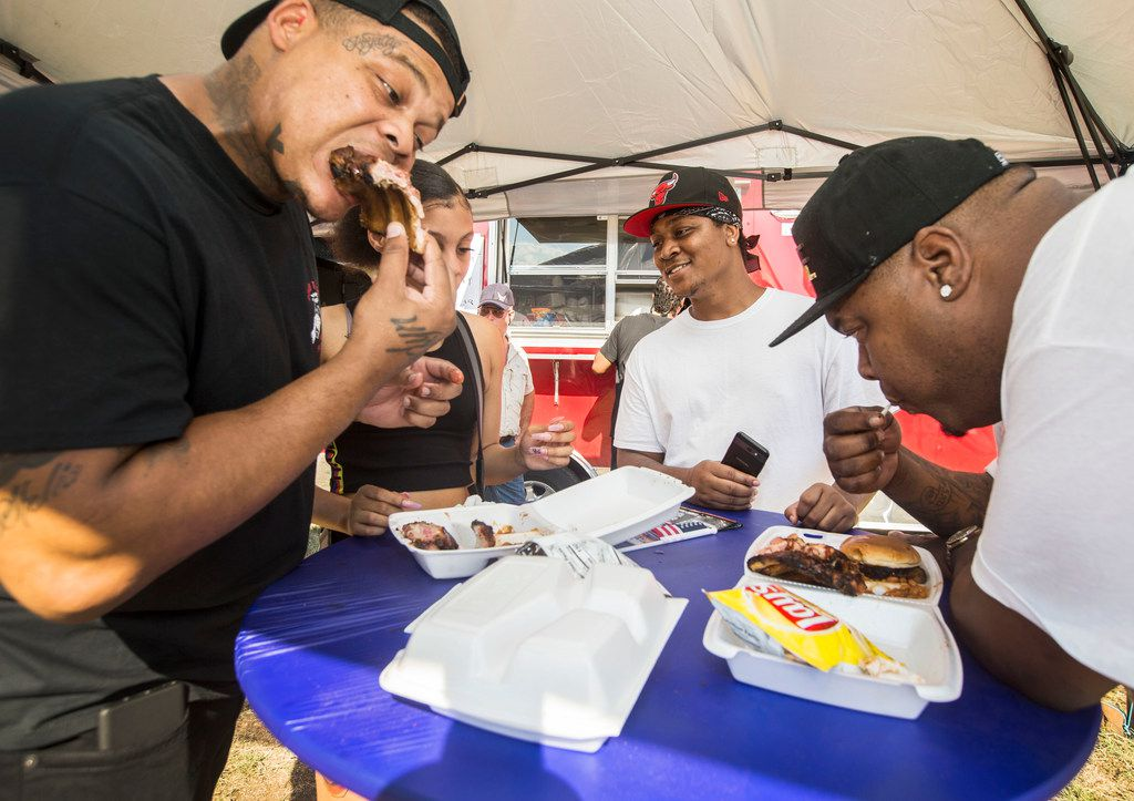 From left, Mark Noble, Paisley Rodriguez, King Noble and Finesse Walker, all of Houston, eat food from Lennie Blues N' BBQ during the 2018 Bedford Blues and BBQ Festival.