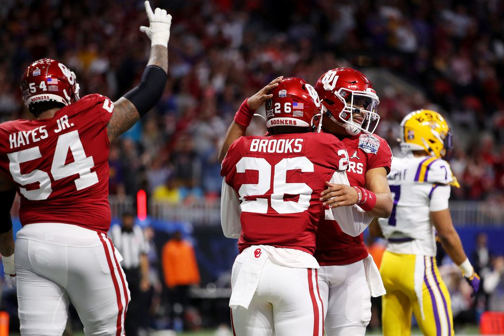 ATLANTA, GEORGIA - DECEMBER 28: Quarterback Jalen Hurts #1 of the Oklahoma Sooners and teammates celebrate a touchdown in the first quarter over the LSU Tigers during the Chick-fil-A Peach Bowl at Mercedes-Benz Stadium on December 28, 2019 in Atlanta, Georgia.