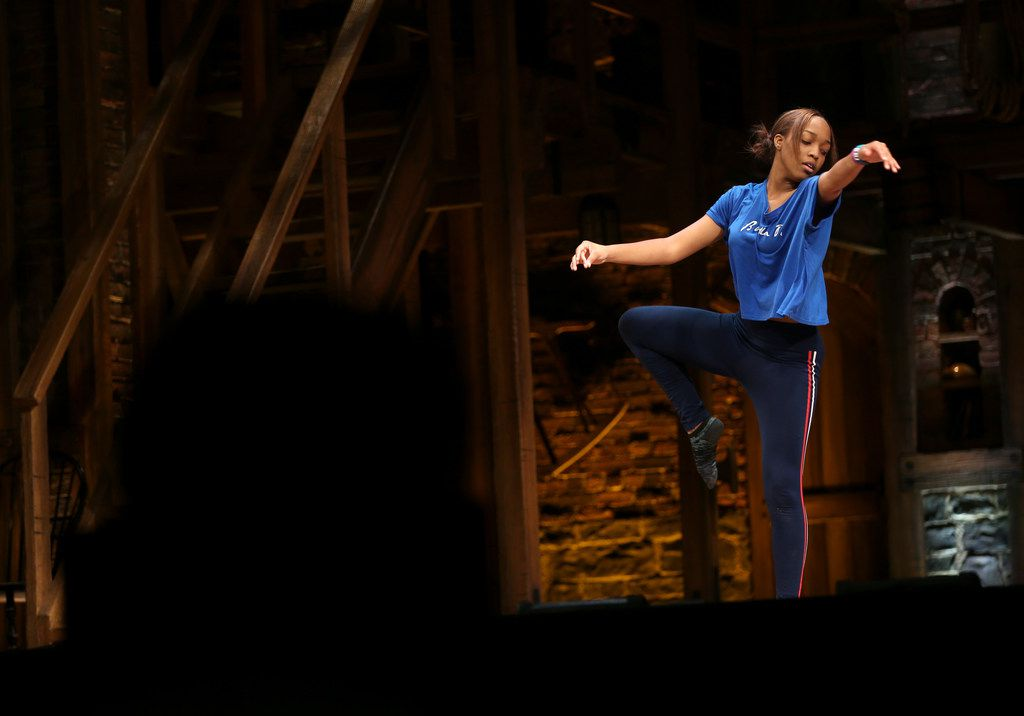 A Booker T. Washington student performs an interpretive dance during a Hamilton Education Program event at the Music Hall at Fair Park in Dallas on May 2, 2019.