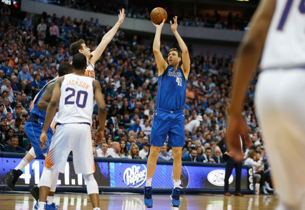 Dallas Mavericks forward Dirk Nowitzki (41) shoots in a game against the Phoenix Suns during the first half of play at American Airlines Center in Dallas on Tuesday, April 9, 2019. (Vernon Bryant/The Dallas Morning News)