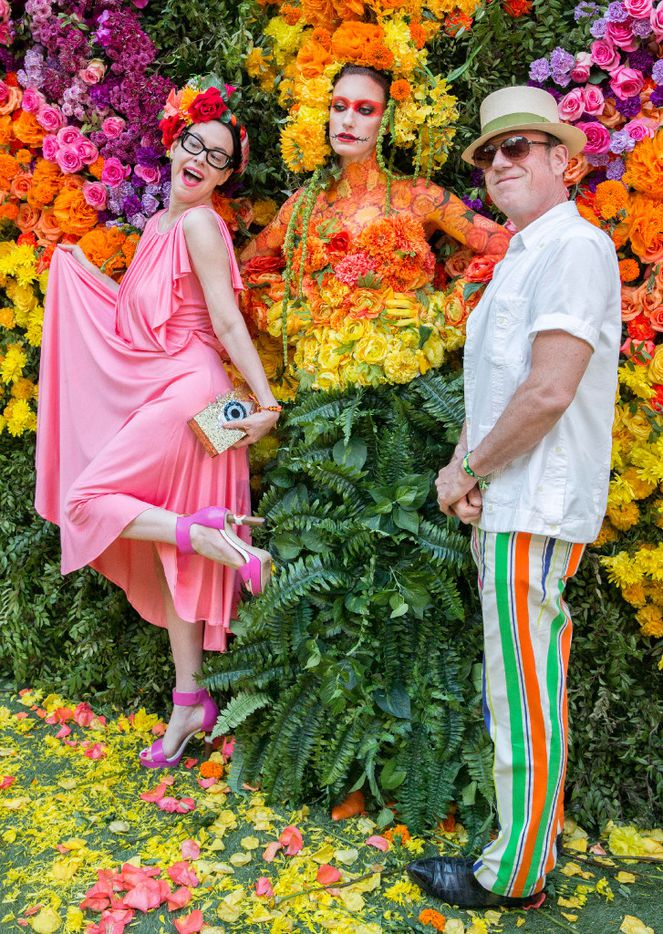 Kendall Morgan and Tim O'Heir pose at the floral wall at the Eye Ball party. (Ron Heflin/Special Contributor)