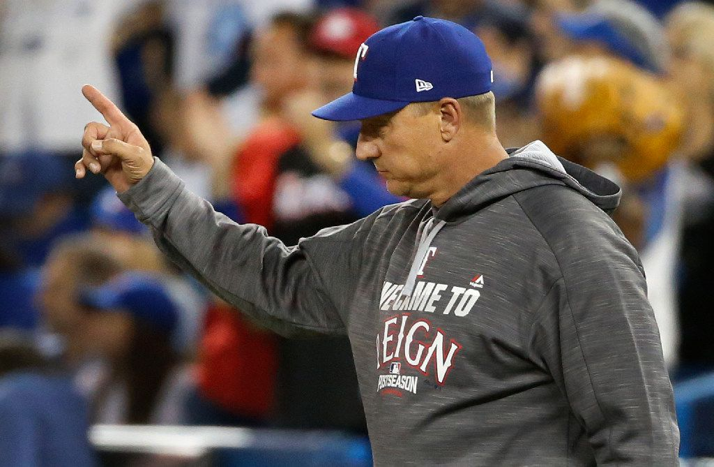 Texas Rangers manager Jeff Banister (28) makes a pitching change during the Texas Rangers vs. Toronto Blue Jays major league baseball ALDS Game 3 at the Roger Centre in Toronto, Ontario, Canada, on Sunday, October 9, 2016. (Louis DeLuca/The Dallas Morning News)