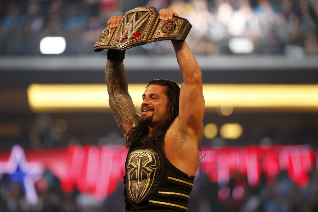 Roman Reigns holds up the championship belt after defeating Triple H during WrestleMania 32 at AT&T Stadium in Arlington, Texas, Sunday, April 3, 2016.
