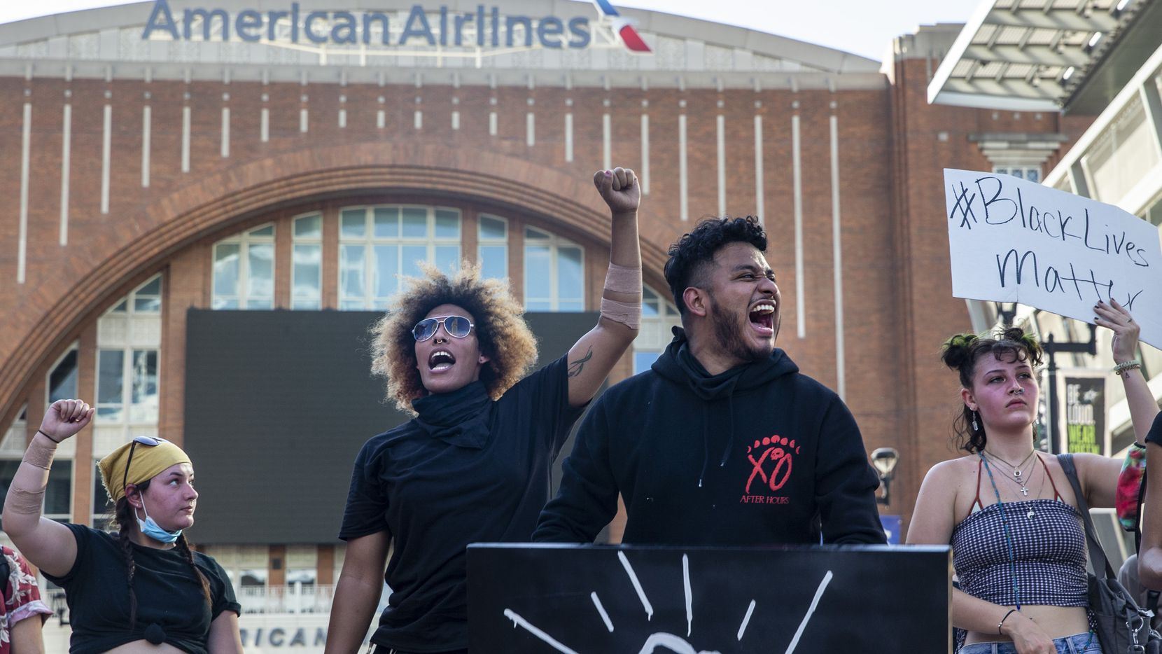Miguel Ibarra (center right) joined other protesters during a June 4 demonstration at American Airlines Center to denounce police brutality and systemic racism. The arena will house a pop-up testing site on Wednesday and Thursday for protesters.