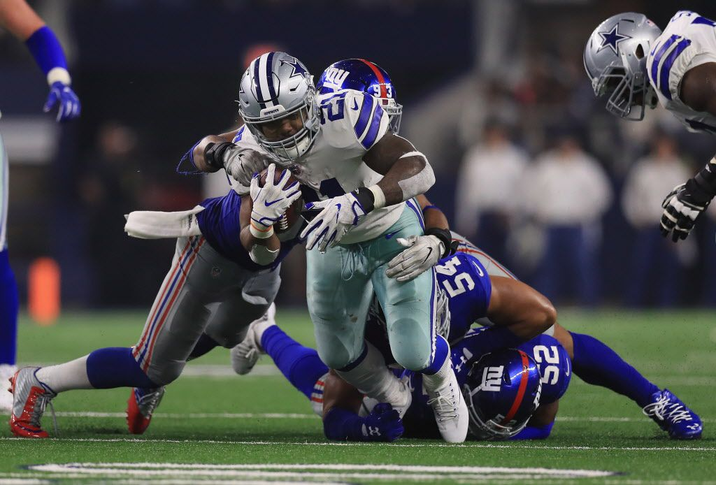 ARLINGTON, TX - SEPTEMBER 10:  Ezekiel Elliott #21 of the Dallas Cowboys is tackled by  B.J. Goodson #93 and  Olivier Vernon #54 of the New York Giants at AT&T Stadium on September 10, 2017 in Arlington, Texas.  (Photo by Ronald Martinez/Getty Images)