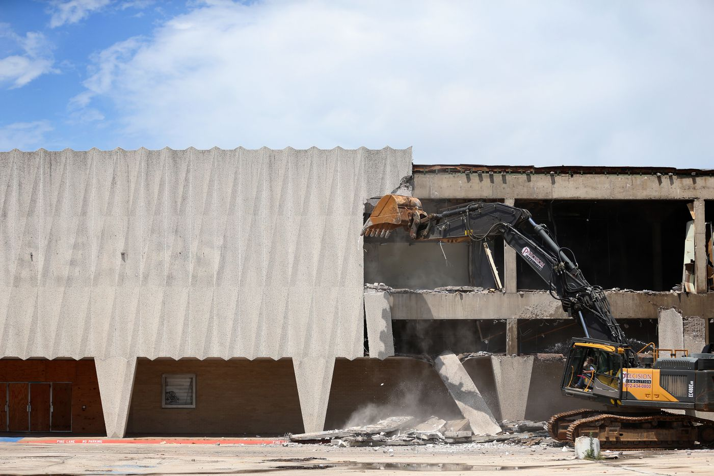 Construction crews demolish the old Sears store at Valley View Mall in Dallas.