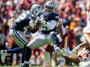 Cowboys running back Ezekiel Elliott (21) runs the ball during the first quarter of a game against the Washington Redskins on Sunday, Sept. 15, 2019, at FedExField in Landover, Md.