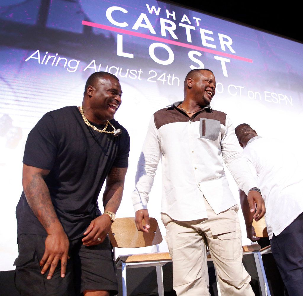 Former Carter High football players Jessie Armstead (left) and Derric Evans broke out laughing following a panel discussion and premier of What Carter Lost, an ESPN documentary about the 1988 Carter football team shown at the Texas Theatre in Dallas, Wednesday, August 16, 2017. (Tom Fox/The Dallas Morning News)