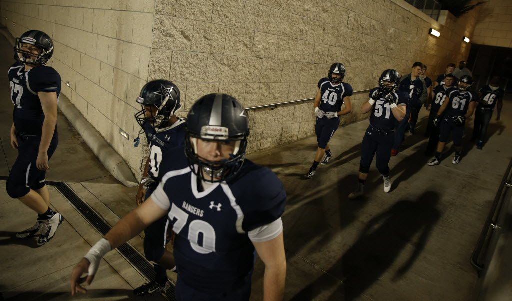 The Frisco Lone Star football team enters the field before their game against Lake Dallas at Eagle Stadium in Allen December 11, 2015. (Nathan Hunsinger The Dallas Morning News)
