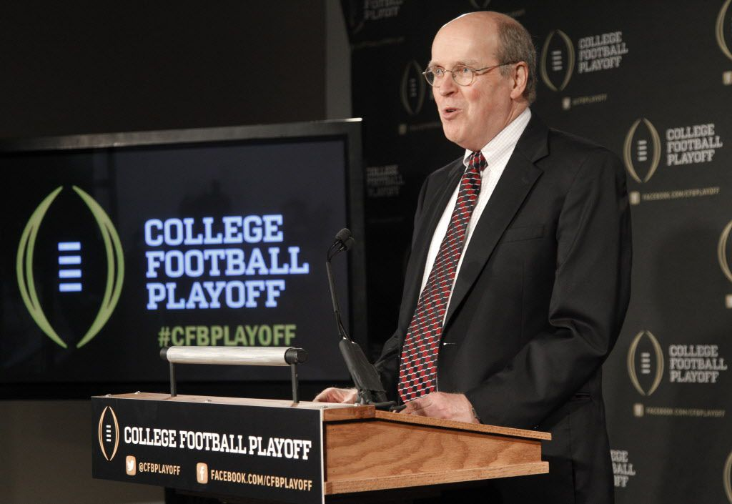 FILE - In this Oct. 16, 2013, file photo, Bowl Championship Series Executive Director Bill Hancock announces the 13 members of the College Football Playoff committee during a news conference in Irving, Texas. Hancock and the FBS conference commissioners are meeting this week in Dallas to work out the remaining details of the four-team playoff that will replace the Bowl Championship Series this season.