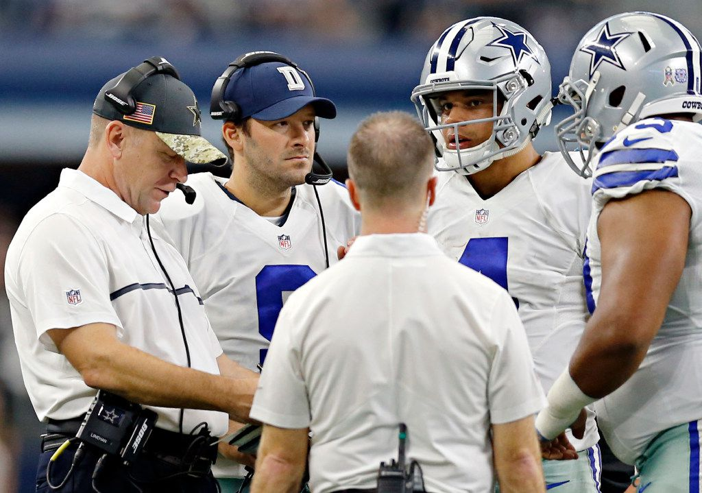 (From left) Dallas Cowboys offensive coordinator Scott Linehan, backup quarterback Tony Romo and quarterback Dak Prescott talk during a time out in the second half of Dallas' 27-17 win over the Baltimore Ravens Sunday, November 20, 2016 in Arlington, Texas. (G.J. McCarthy/The Dallas Morning News)