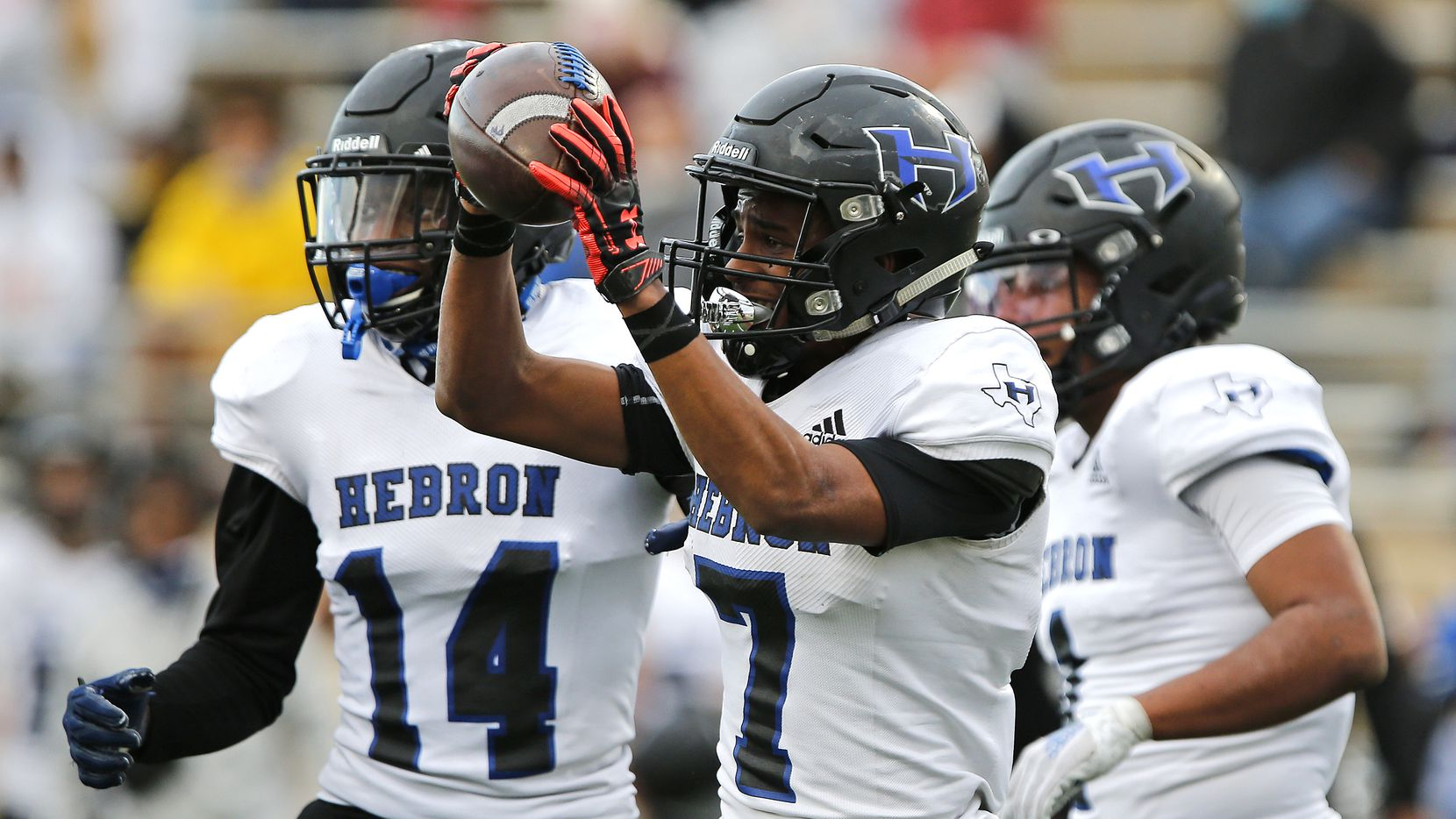 *Hebron High School defensive back Trenton Bronaugh (7) holds up the ball he intercepted near the end of the game as Plano West High School hosted Hebron High School in a District 6-6A football game at Clark Stadium in Plano on Friday, November 27, 2020.