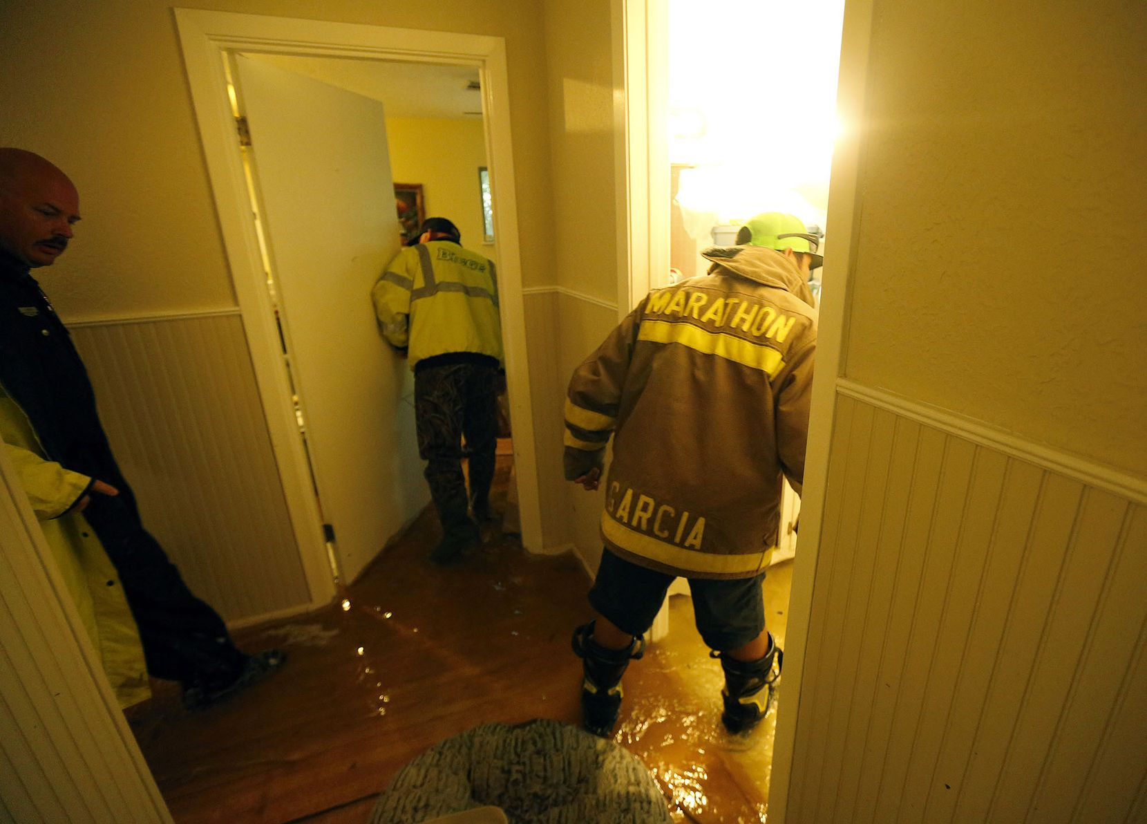 Dickinson police and fire officials search a Dickinson, Texas house they got a welfare check on Monday, Aug. 28, 2017 in the wake of Hurricane Harvey. They couldn't find anyone at the home.