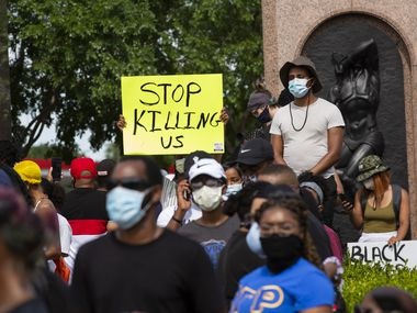 Demonstrators stage a vigil to honor those lost as a result of police brutality at Freedman's Memorial Cemetery on Sunday, May 31, 2020 in Dallas. (Juan Figueroa/ The Dallas Morning News)
