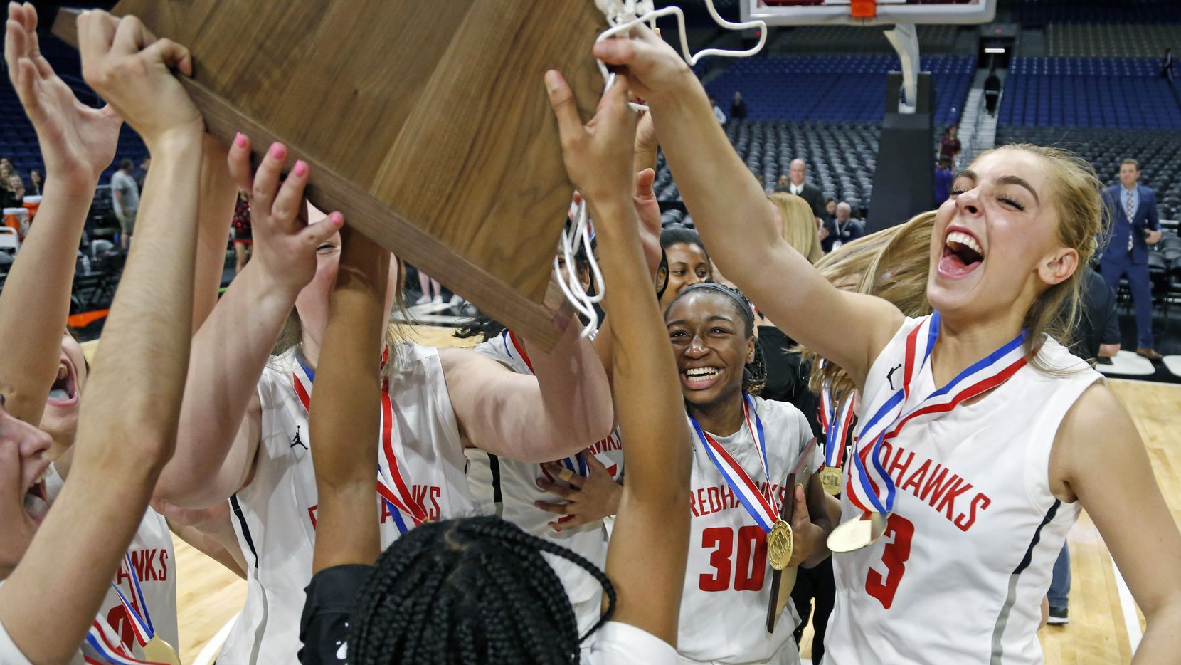 Frisco Liberty's Lily Ziemkiewicz (3) and Jazzy Owens-Barnet (30) celebrate with their teammates after beating San Antonio Veterans Memorial 35-26 in the Class 5A state championship game on March 7, 2020 at the Alamodome in San Antonio.