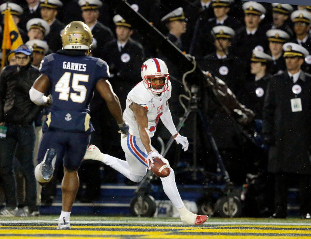 Southern Methodist Mustangs wide receiver James Proche (3) cruises into the end zone ahead of Navy Midshipmen safety Chelen Garnes (45) during the second quarter at Navy-Marine Corps Memorial Stadium in Annapolis, Maryland, Saturday, November 23, 2019. (Tom Fox/The Dallas Morning News)