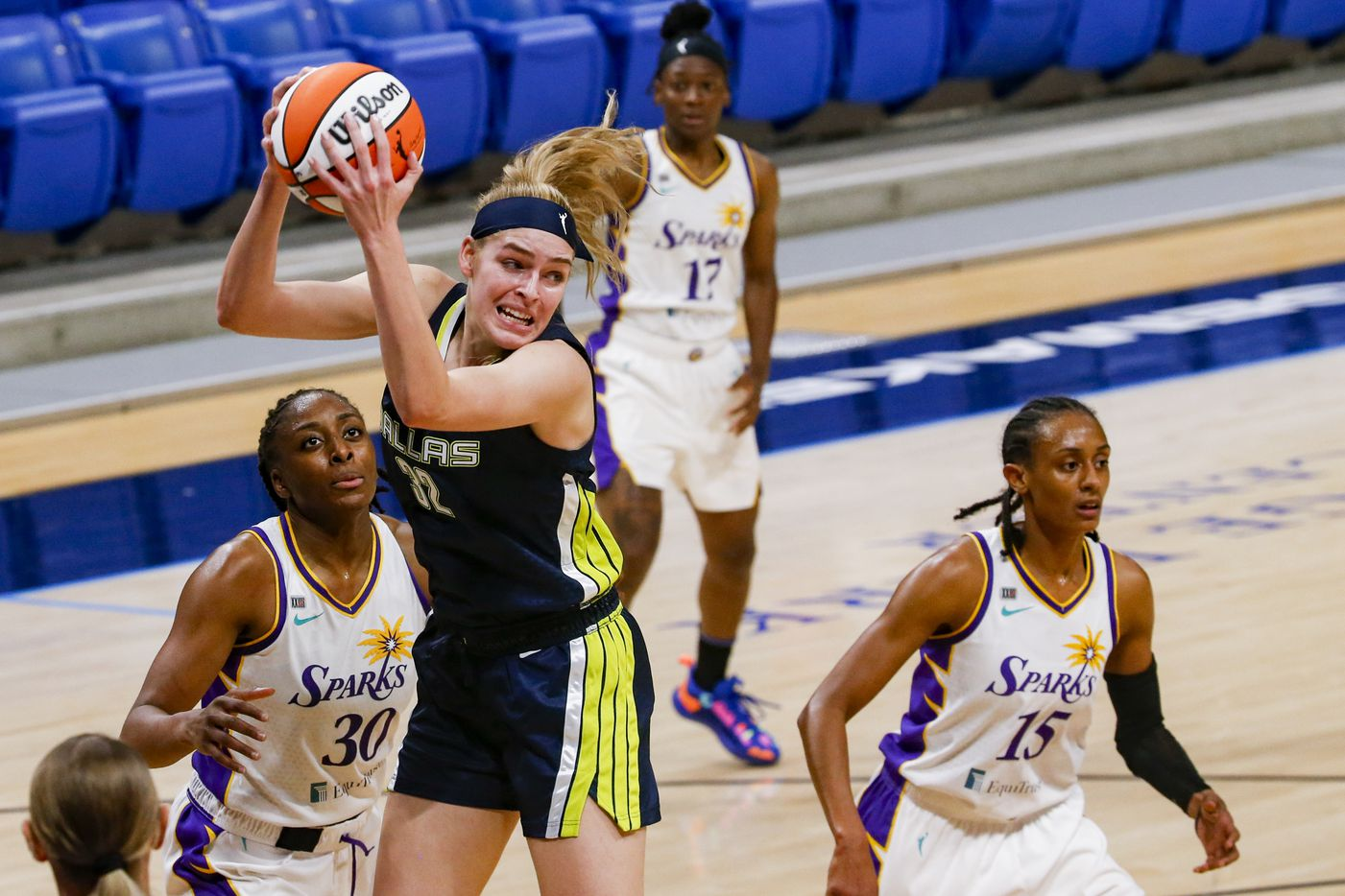 Dallas Wings center/forward Bella Alarie (32) grabs a Dallas Wings rebound against the Los Angeles Sparks at College Park Center on Tuesday, June 1, 2021, in Arlington. (Juan Figueroa/The Dallas Morning News)
