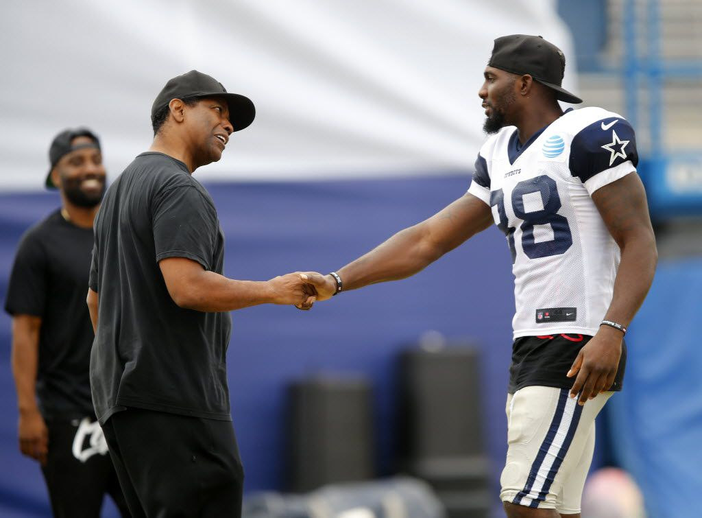 Dallas Cowboys fan and actor Denzel Washington (right) meets with Dallas Cowboys wide receiver Dez Bryant (88)  following afternoon practice at training camp in Oxnard, California, Saturday, August 6, 2016. Washington spent the practice in the field tower with Jones. (Tom Fox/The Dallas Morning News)