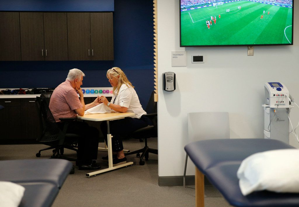 Hal Daughtery, of Plano (left) works with Alison Taylor, certified hand therapist (right) during a therapy session at in the Baylor Scott & White Institute for Rehabilitation area at the Baylor Scott & White Sports Therapy & Research at The Star in Frisco on Monday, June 18, 2018.