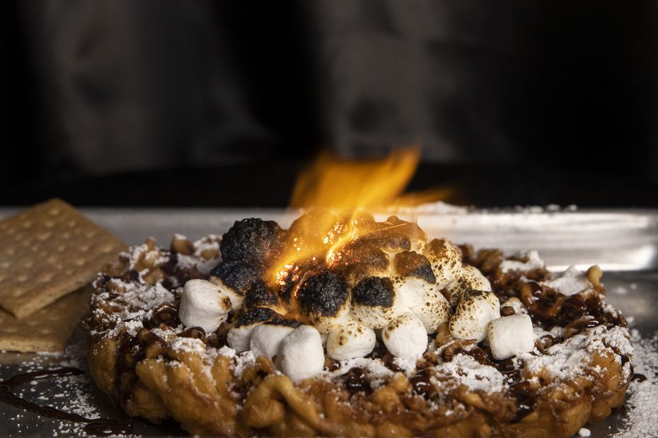 On a Wednesday afternoon in January, middle school and high school kids stopped into CornDog With No Name to order funnel cakes. The Bonfire comes topped with s'mores ingredients.