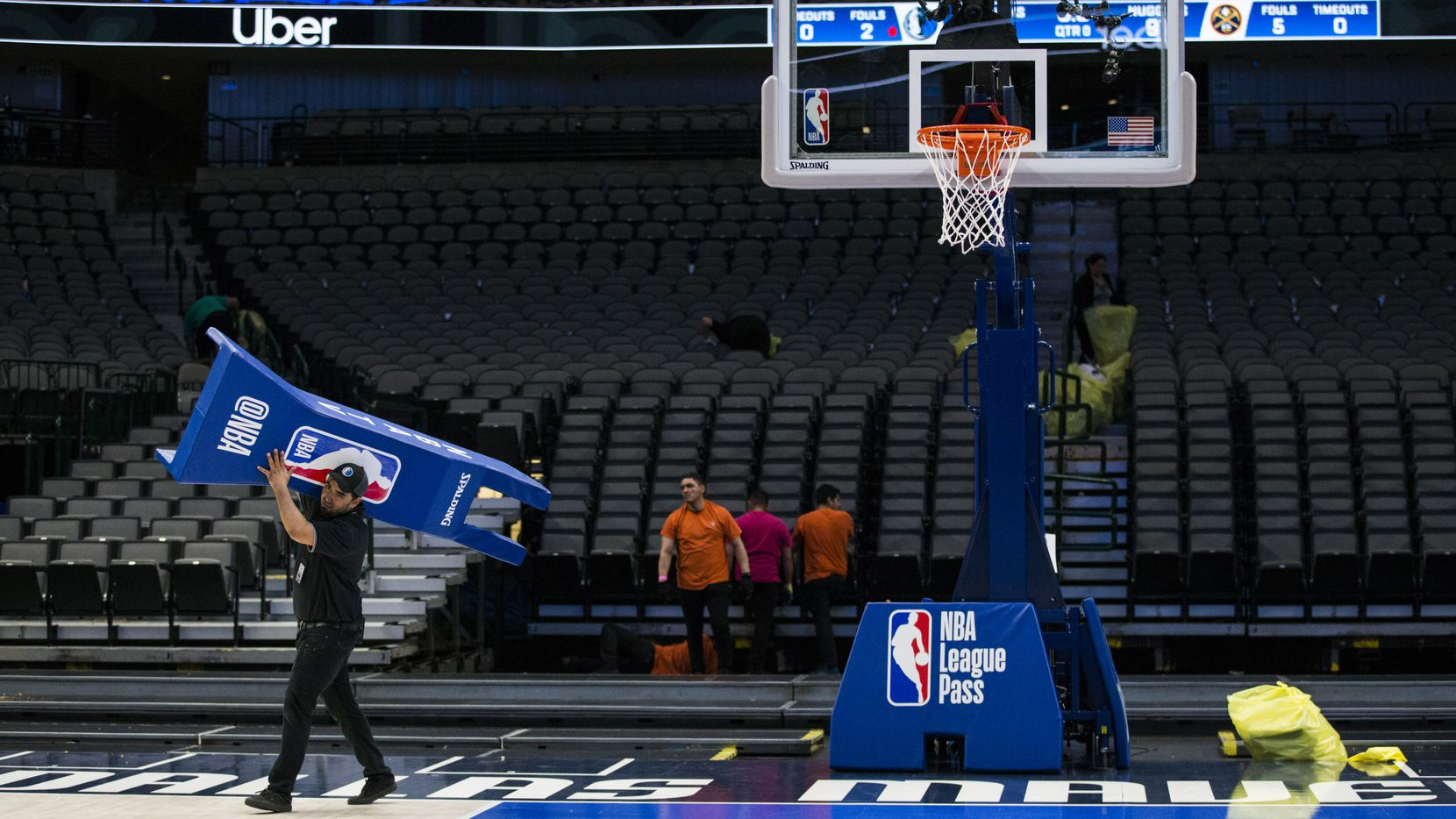 Crews break down the court after the Dallas Mavericks beat the Denver Nuggets 113-97 on Wednesday, March 11, 2020 at American Airlines Center in Dallas. During the game, the NBA suspended all games due to the spread of the new coronavirus.