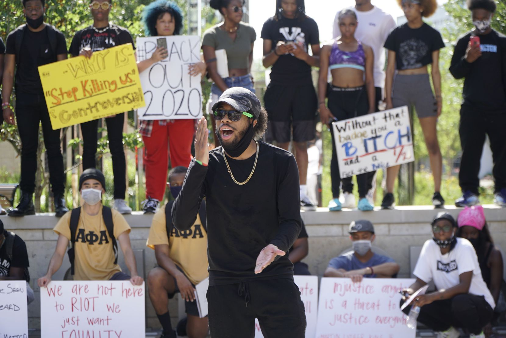 Jibri Burgess speaks to protestors during a march in Arlington, Texas on Tuesday, June 2, 2020. The protest was to show solidarity in the midst of the latest killing of an African American man by police in Minnesota.
