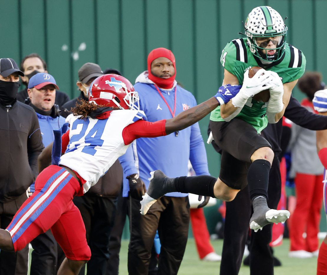 Southlakes Brady Boyd (14) makes a catch in front of Duncanville's Deldrick Madison (24) during the Class 6A Division I state high school football semifinal in Arlington, Texas on Jan. 9, 2020. (Michael Ainsworth)