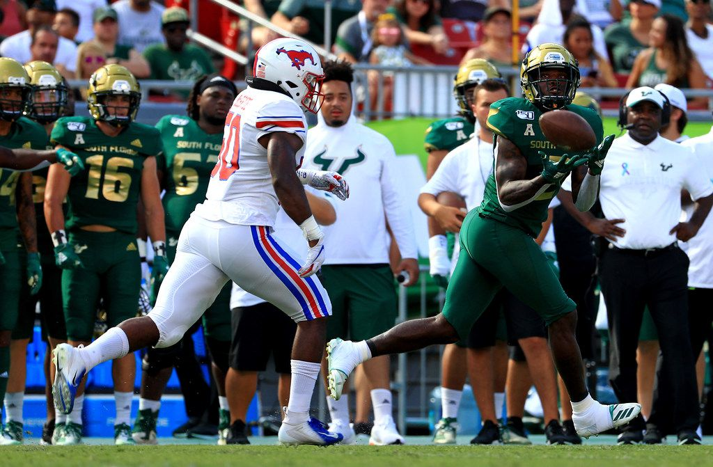 TAMPA, FLORIDA - SEPTEMBER 28: Jordan Cronkrite #2 of the South Florida Bulls makes a catch over Richard McBryde #50 of the Southern Methodist Mustangs during a game  at Raymond James Stadium on September 28, 2019 in Tampa, Florida.