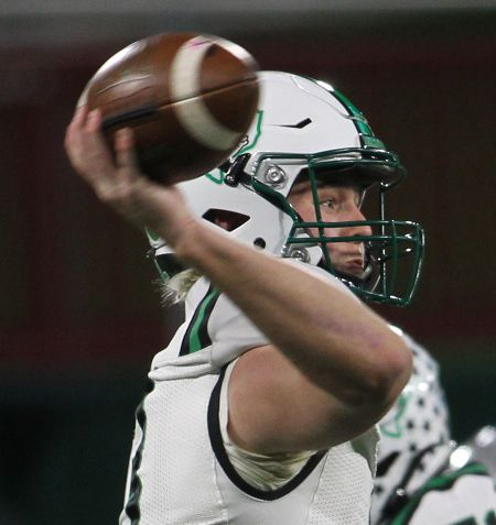 Southlake Carroll quarterback Quinn Ewers (3) launches a first quarter pass in their game against Arlington Martin. The two teams played their Class 6A Division l Region l semifinal football playoff game held at Globe Life Park in Arlington on December 24, 2020. (Steve Hamm/ Special Contributor)