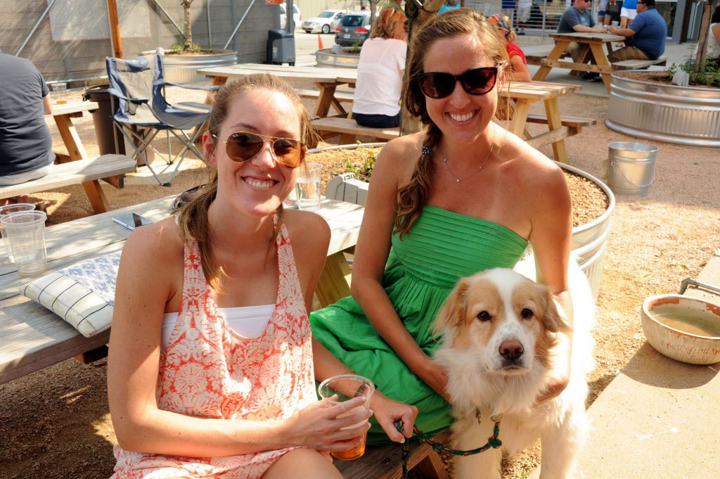 Kendall Childers and Allison Nelson with her puppy Roby enjoy brews, music, and cars at the custom car show at Texas Ale Project in Dallas, TX on August 15, 2015.