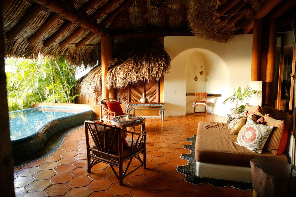 Suites at the Amuleto hotel in Zihuatanejo, Mexico, are nicely appointed, with plenty of lounging options for those seeking a lazy getaway.