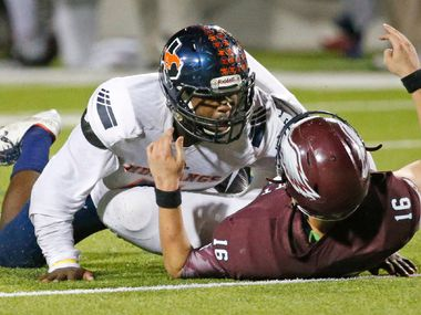 Sachse linebacker Riko Jeffers (7) hovers over Rowlett quarterback Preston Weeks (16) after applying a hard hit as Weeks threw a pass in the fourth quarter during the Sachse High School Mustangs vs. the Rowlett High School Eagles football game at Homer B. Johnson Stadium in Garland, Texas on Friday, October 21, 2016. (Louis DeLuca/The Dallas Morning News)