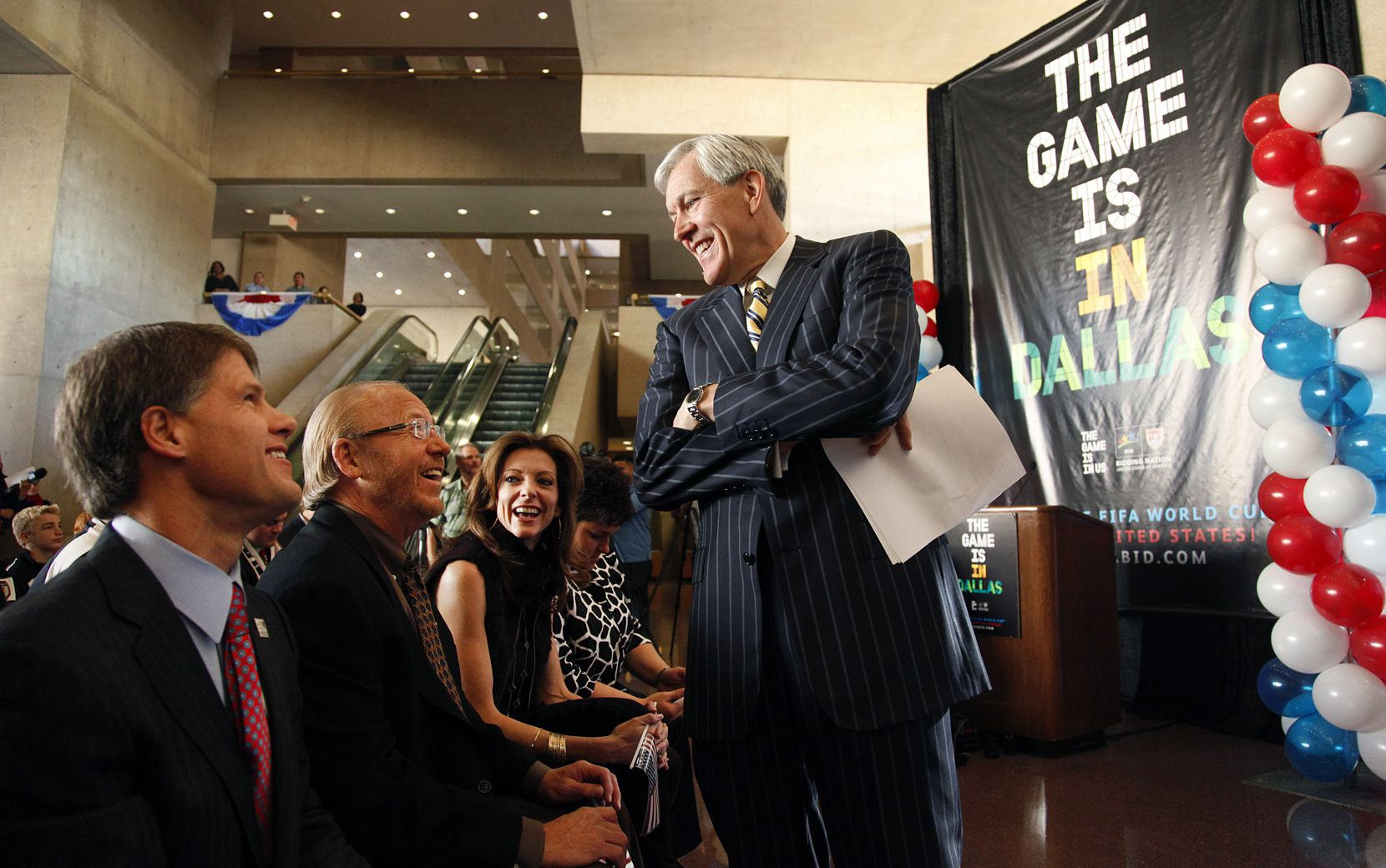 Dallas mayor Tom Leppert (standing) shares a laugh with Jim Graham, (second from left) and Clark Hunt in 2010.