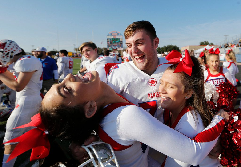 Parish Episcopal's Miles Cuban (71) shares a laugh with cheerleaders in celebration after defeating Plano John Paul II 42-14 in the TAPPS Division I State Championship game at Waco Midway's Panther Stadium in Hewitt, Texas on Friday, December 6, 2019. (Vernon Bryant/The Dallas Morning News)