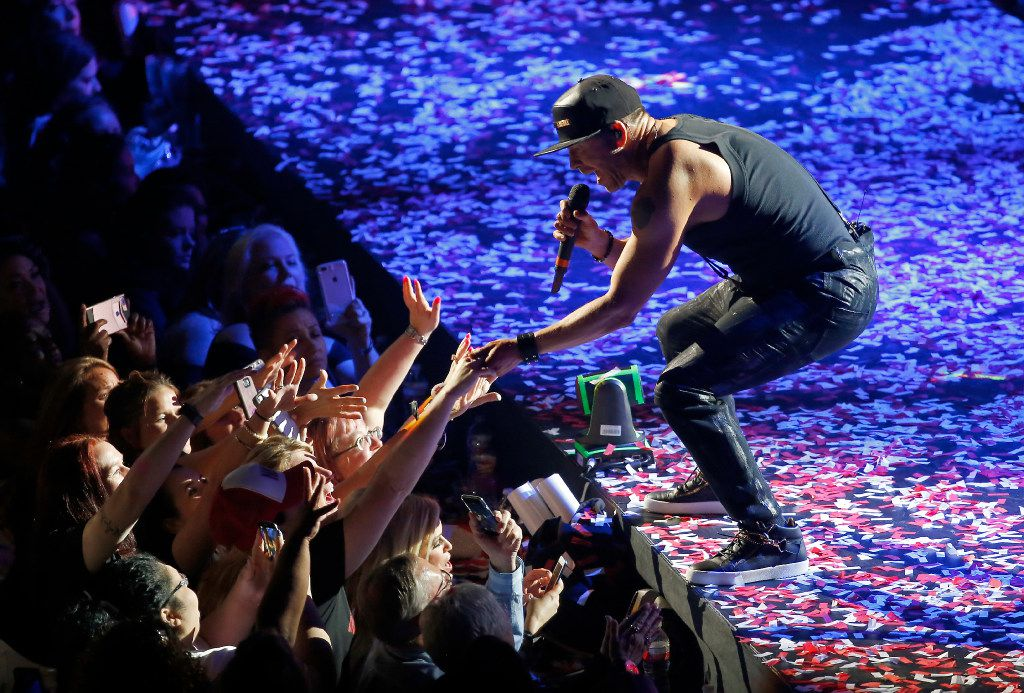 New Kids On The Block's Donnie Wahlberg reaches out to fans during the group's Total Package Tour at American Airlines Center.