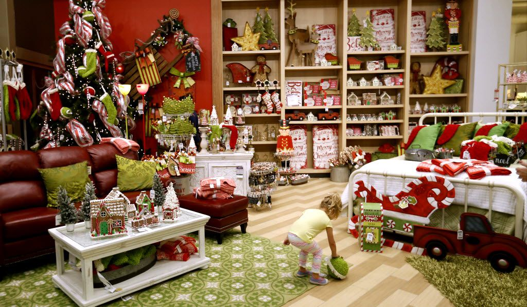 Harlow Wattenburger, 3, is seen in a holiday decor merchandise area with a variety of holiday themed items at Nebraska Furniture Mart in The Colony on Nov. 20, 2015.